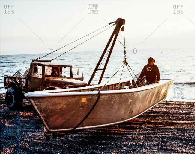 Clam Gulch, Alaska - August 28, 2006: Man elevating a boat with a truck