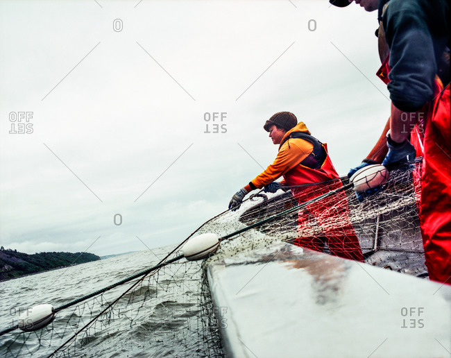 Clam Gulch, Alaska - August 28, 2006: Alaskan fishermen pulling in a fishing net