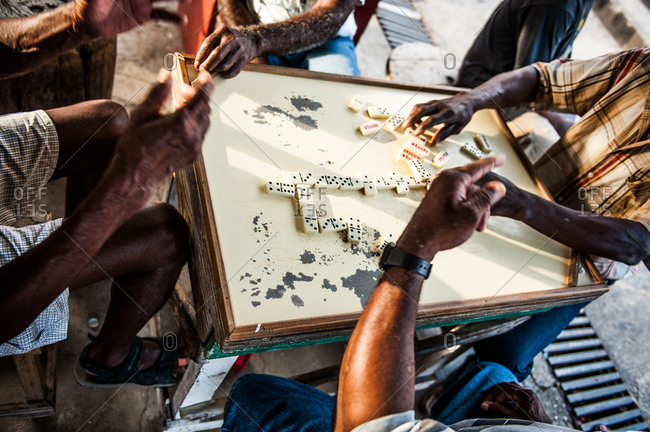 Local men playing dominoes in Barbados