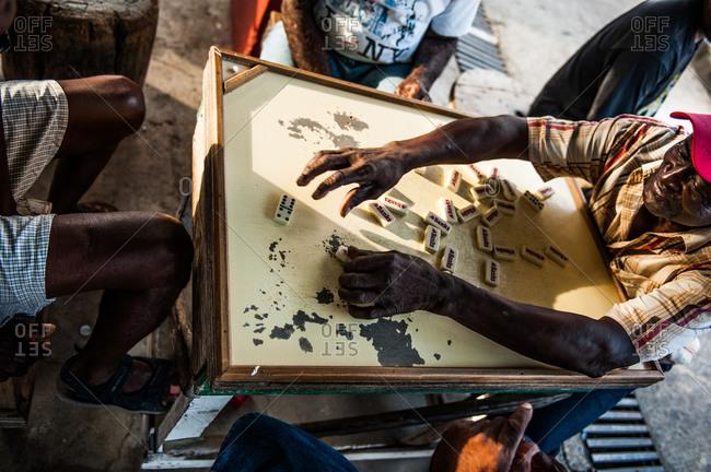 Barbados - May 19, 2008: Elderly men playing dominoes