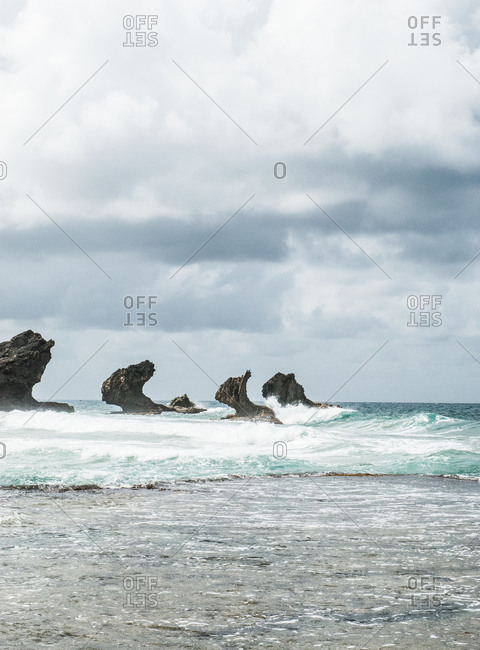 Rock formation in the stormy sea