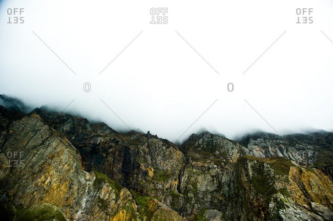 The fog descends the rocky mountains near Donegal, Ireland