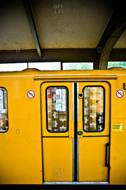 Yellow subway car in Berlin, Germany