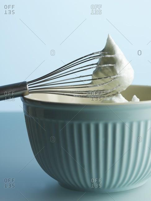 Whisked egg white on the egg whisk