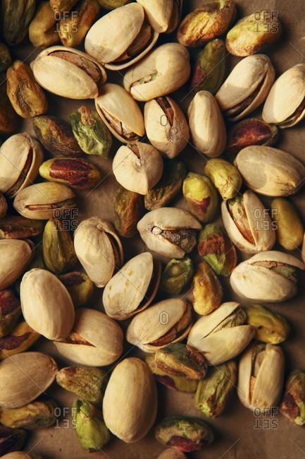 Lots of pistachios on a table