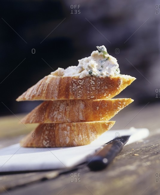 Cheese and salmon spread on baguette slices