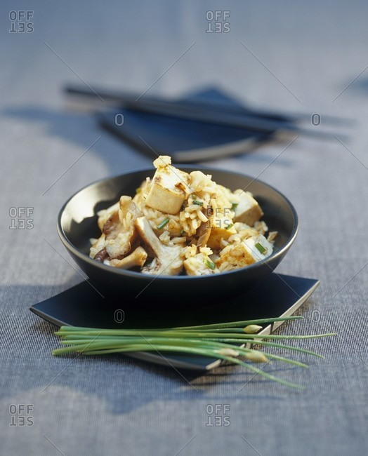 Fried tofu with rice and mushrooms