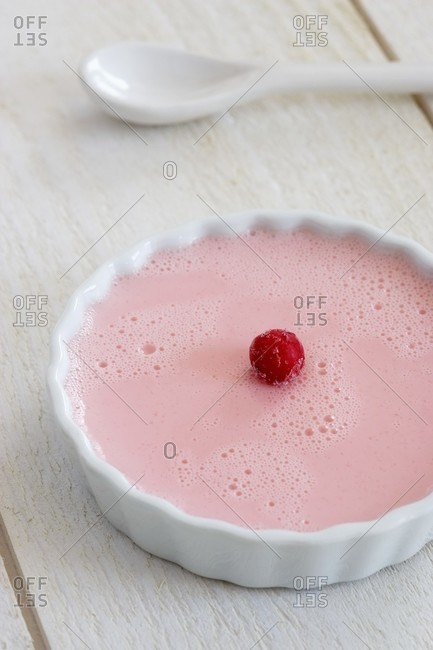 A raspberry flan in a round dish