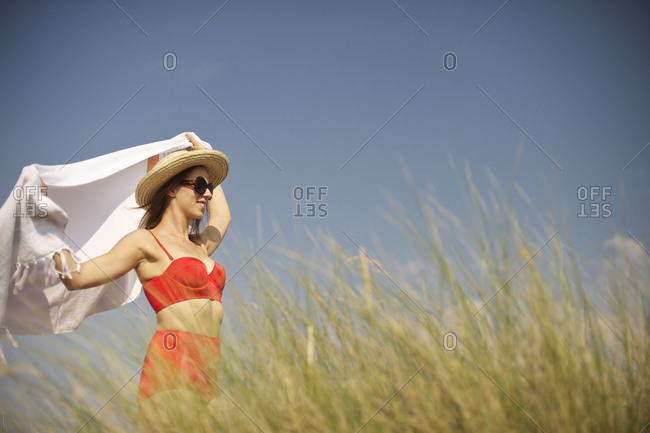 Woman standing in the summer breeze