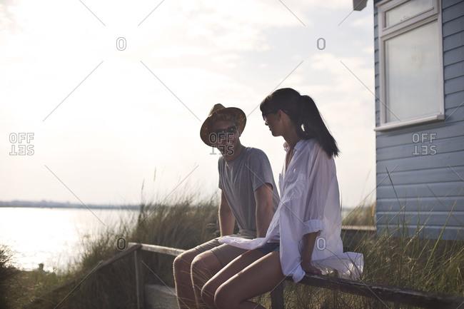 Couple sitting on a railing