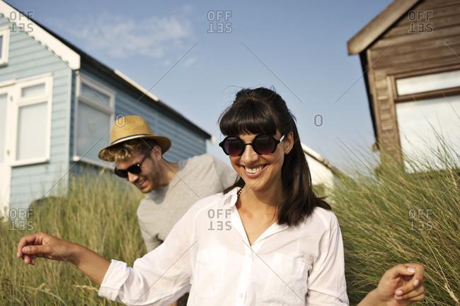 Couple walking across tall grass