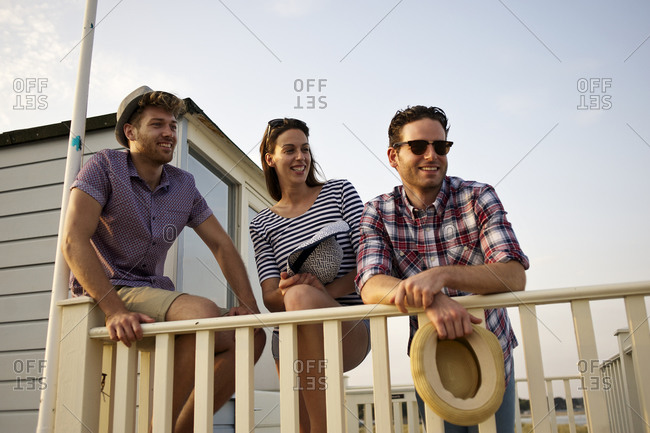Smiling people relaxing on a balcony