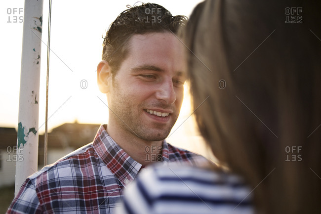 Portrait of a smiling man at sunset