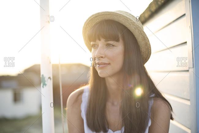 Portrait of a brunette woman in hat