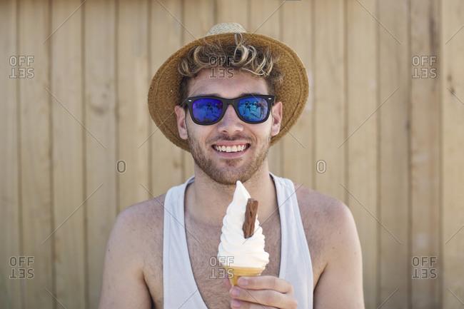 Boy holding swirl ice cream