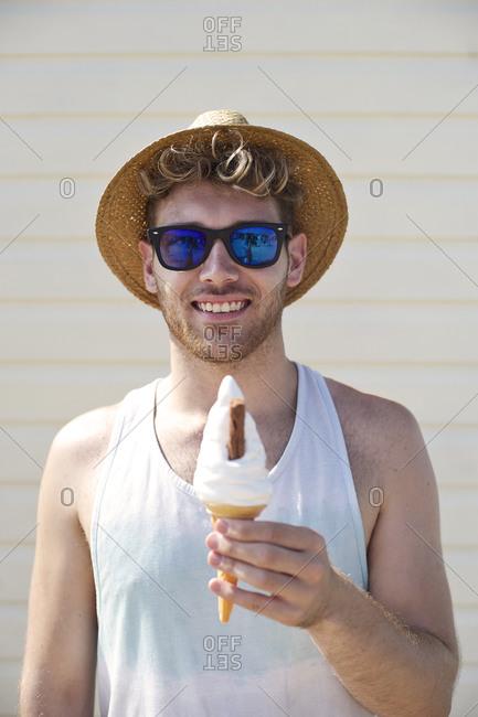 Smiling boy holding swirl ice cream