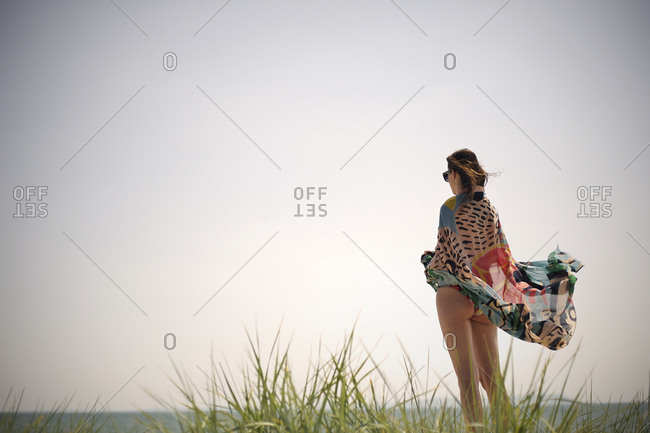 Young woman standing in summer breeze