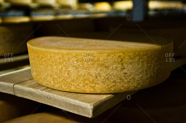 Close up of raclette cheese on wooden shelf