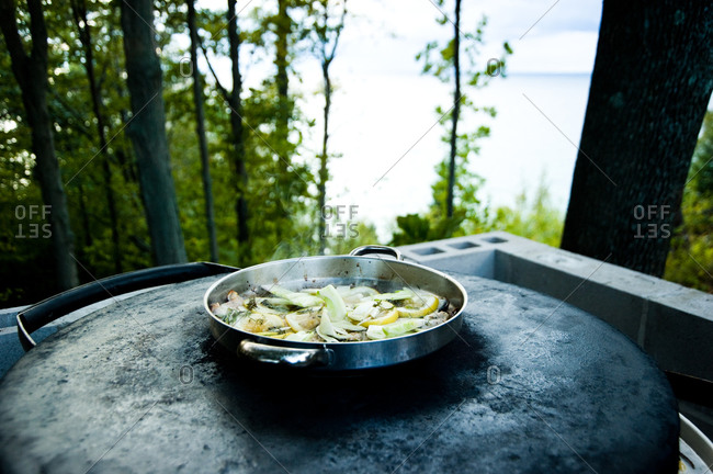 Lemon and fennel steaming on an outdoor burner