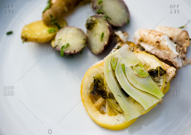 Roasted chicken with fennel and lemon served with potato