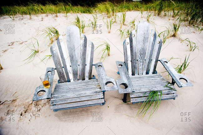 Wooden chairs on a sandy beach