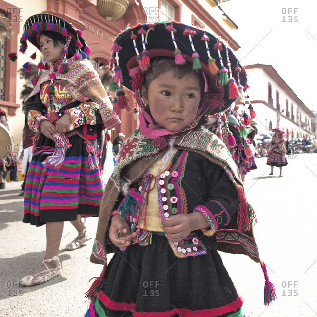 Puno, Peru - February 4, 2012: Young girl in traditional clothes during the Virgin of Candelaria Feast