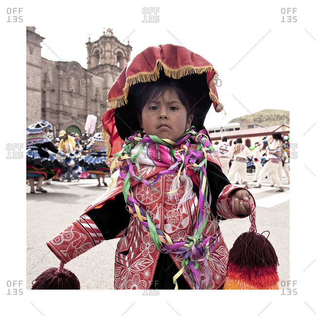 Puno, Peru - February 4, 2012:  Portrait of a  girl in traditional clothes during the Virgin of Candelaria Feast