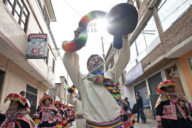 Puno, Peru - February 4, 2012: Man cheering on a street during the Virgin of Candelaria Feast