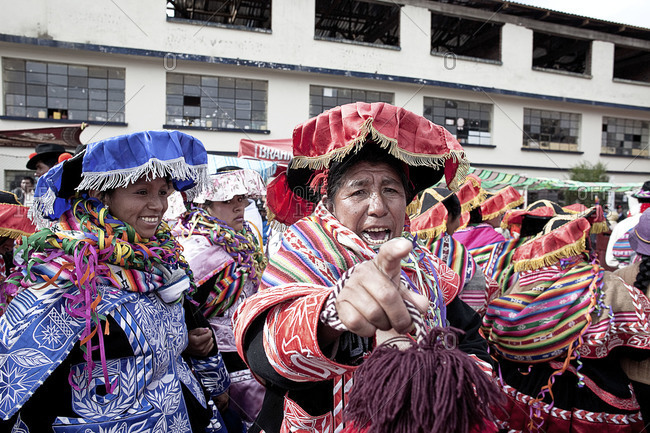 Puno, Peru - February 4, 2012: Woman pointing on a street during the Virgin of Candelaria Feast