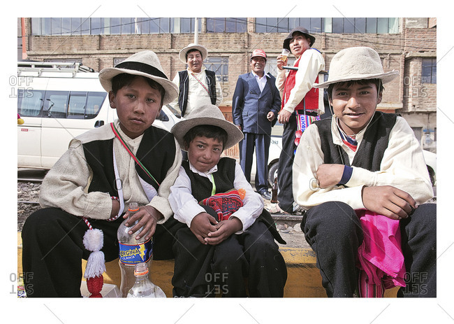 Puno, Peru - February 4, 2012: Portrait of three young boys during the Virgin of Candelaria Feast