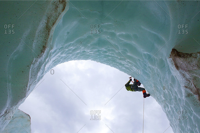 Alpinist climbing on a glacier in Patagonia, Chile