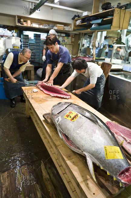 Tokyo, Japan - July 6, 2008: Preparing fresh fish at Tsukiji Fish Market