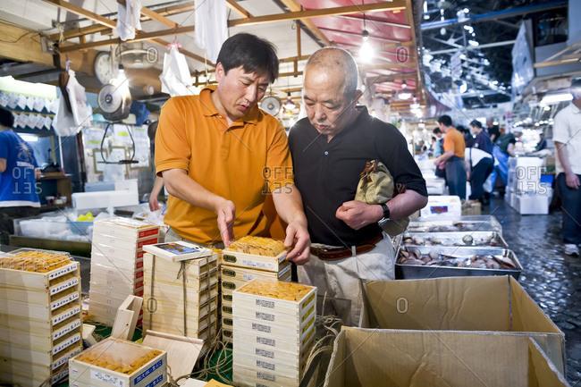 Tokyo, Japan - July 9, 2008: Buying and selling at Tsukiji Fish Market