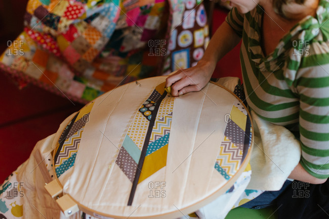 Woman making a patchwork quilt