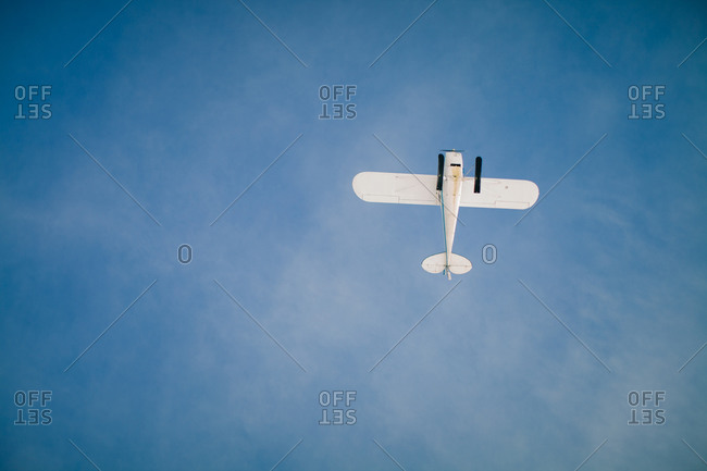 Low angle view of a light aircraft flying in the sky