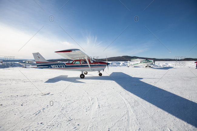 Small aircrafts in a snowy field