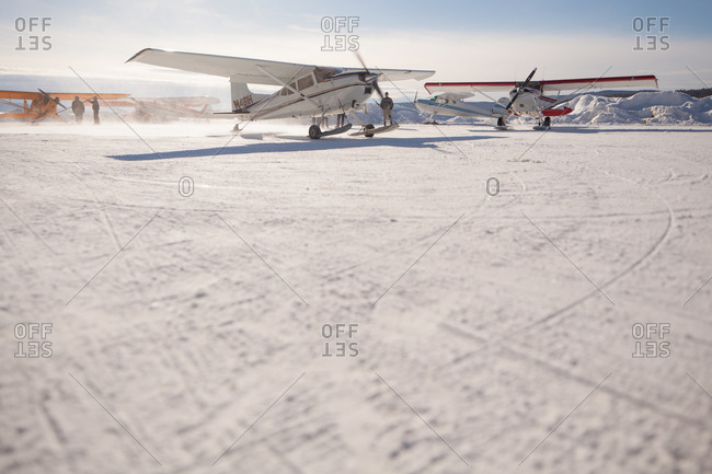 Small aircraft ready to take off in a snowy field