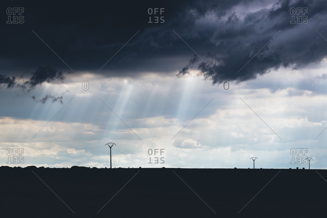 Cloudy sky and power pylons