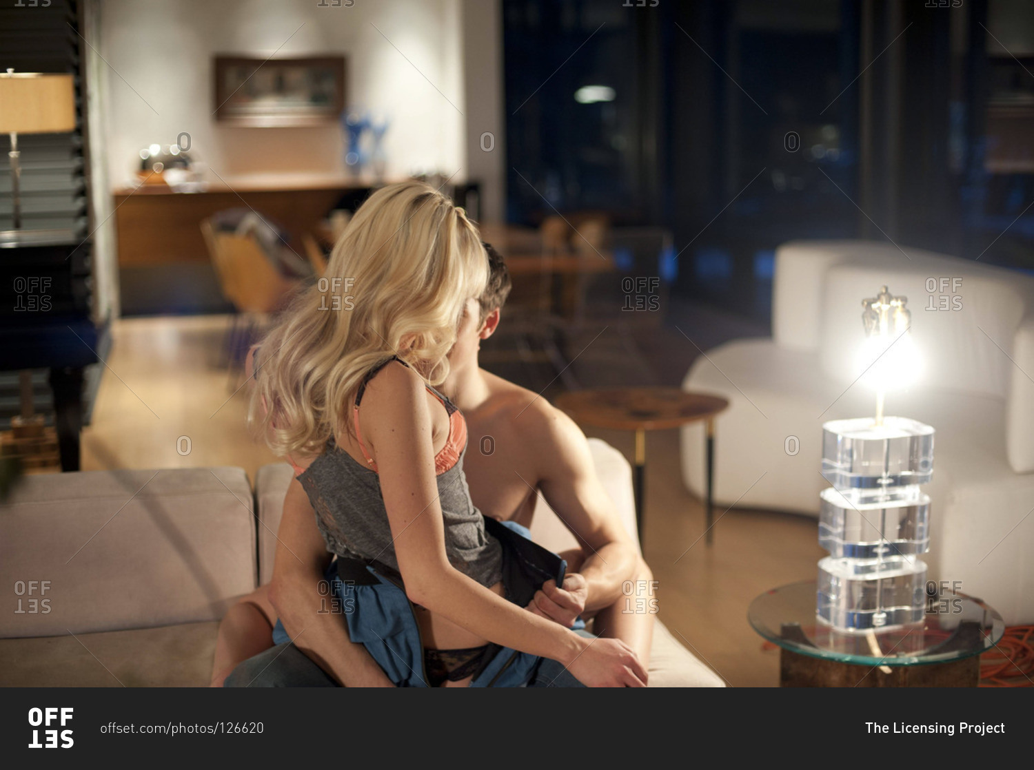 Man undressing His Woman in the Sofa Stock Photo - Offset-5603