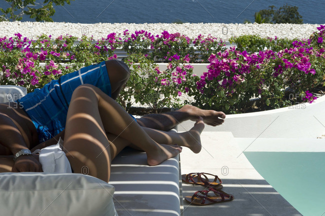 Couple relaxing on a sun bed