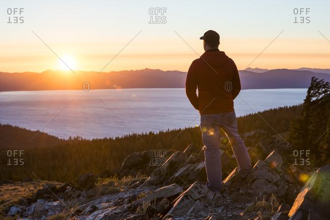 Silhouette of a man watching the sunset over Lake Tahoe from the top of Genoa Peak, Nevada