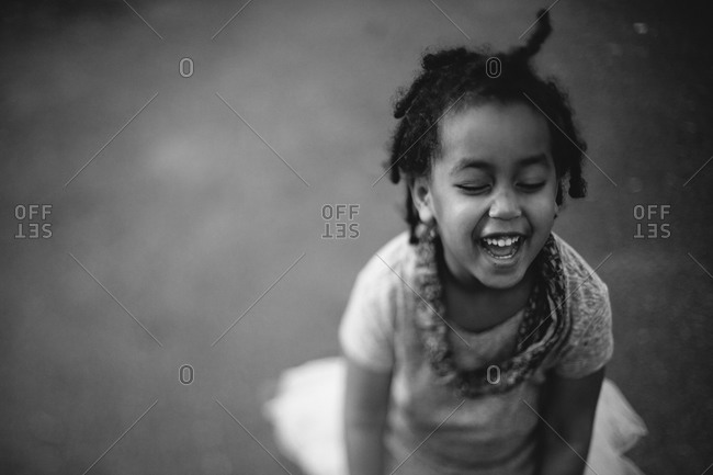 High angle view of little girl laughing