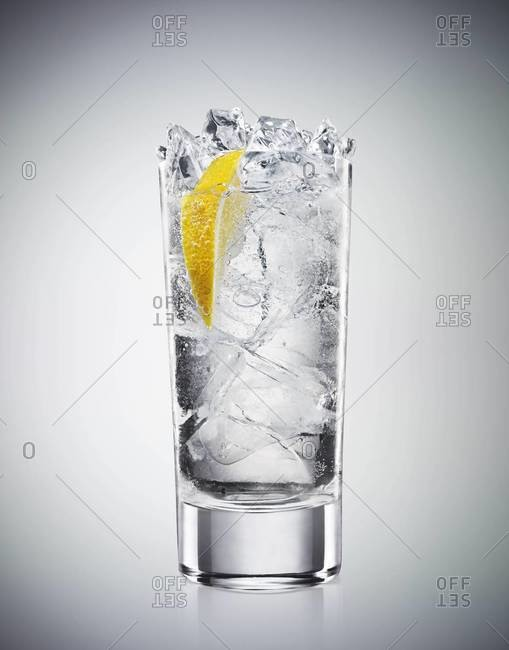 Studio shot of a drink with soda and lemon