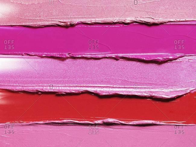 Studio shot of smeared lipsticks