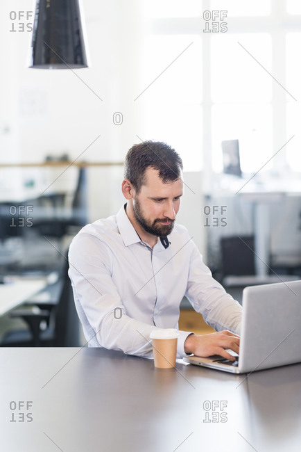 Mid adult businessman in office