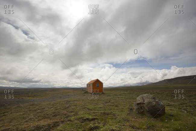 Red wooden mountain hut on a piste