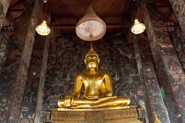 Bangkok, Thailand - December 8, 2009: Golden Buddha at Wat Suthat Thepwararam