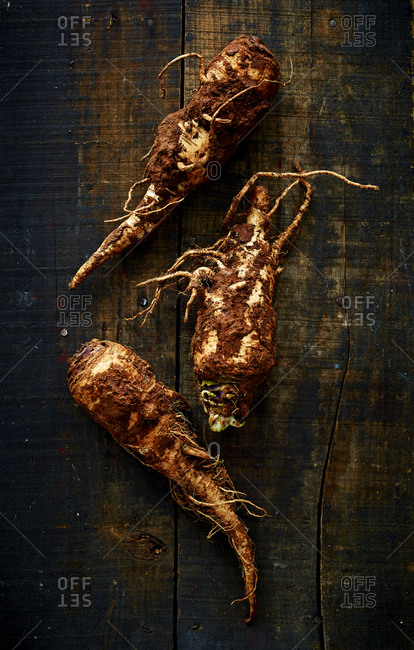 Turnips tubers on wooden surface