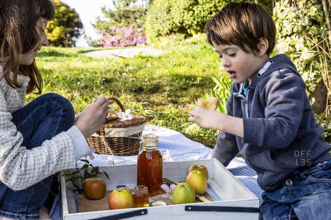 Kids having snack in the garden