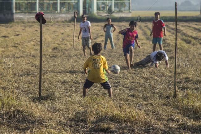 Rach Gia, Vietnam - June 26, 2014: Children playing soccer in Rach Gia, Vietnam